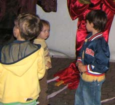 Kids in front of parade items, getting ready